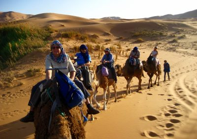 Arriving at the nomad campsite on a private guided Sahara Desert trek with Experience Morocco