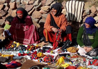 Berber nomad women selling locally made products in Jebel Saghro mountain range in Morocco