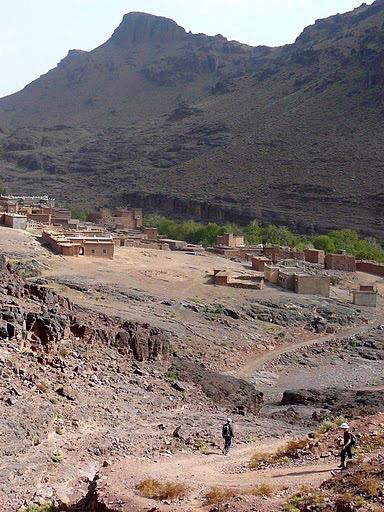 Hiking past a Berber village in Jebel Saghro mountain range