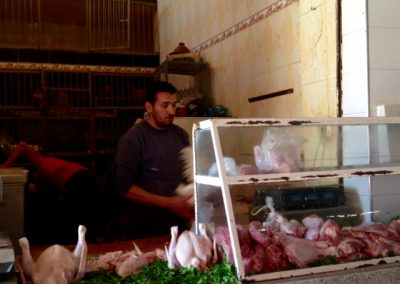 Buying chicken from the live chicken seller in the Marrakech souk