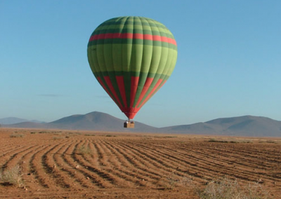 Hot air balloon landing in the countryside near Marrakech