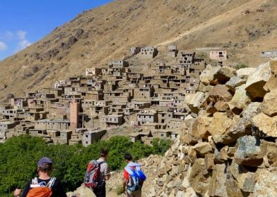 Hiking through the Berber village of Amskerou in the High Atlas Mountains of Morocco
