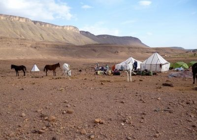 Campsite with Jebel Saghro mountain range in Morocco behind