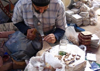 Man chipping tiles at a ceramics factory in Fes in Morocco