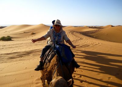 Camel riding on a private guided Sahara Desert trek with Experience Morocco