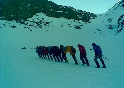 Trekking through the snow on a private guided winter trek to Jebel Toubkal with Experience Morocco