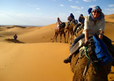 Heading into the Sahara Desert on a private guided camel trek with Experience Morocco