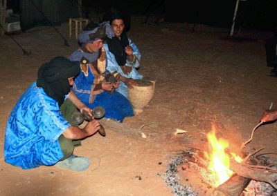 Listening to traditional Berber music around the campfire on a Sahara Desert trek with Experience Morocco