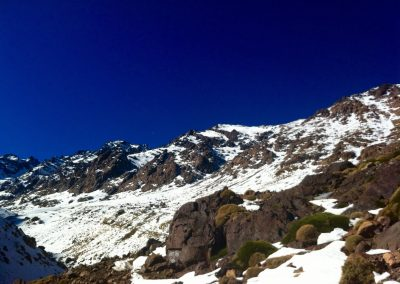 Snow and rocks on the way to the Nelter base camp near Jebel Toubkal in Morocco