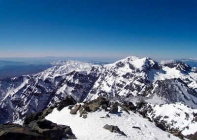 Snowy peaks in the High Atlas Mountains of Morocco as seen from Jebel Toubkal summit.