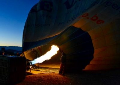 Inflating a hot air balloon at dawn near Marrakech